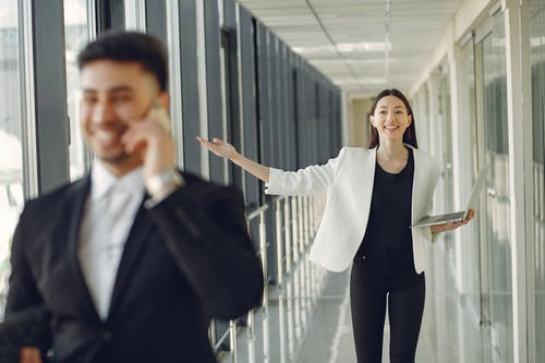 Cheerful colleagues standing in modern office