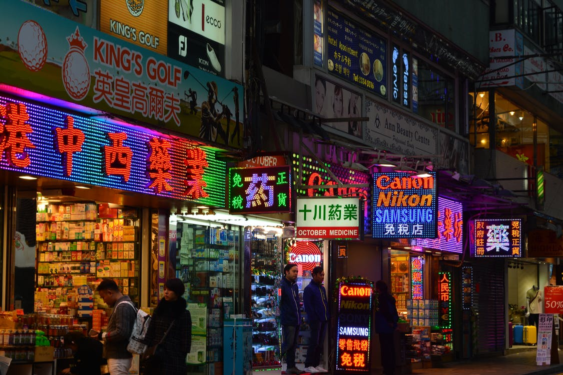Lighted Signage of Store Facades