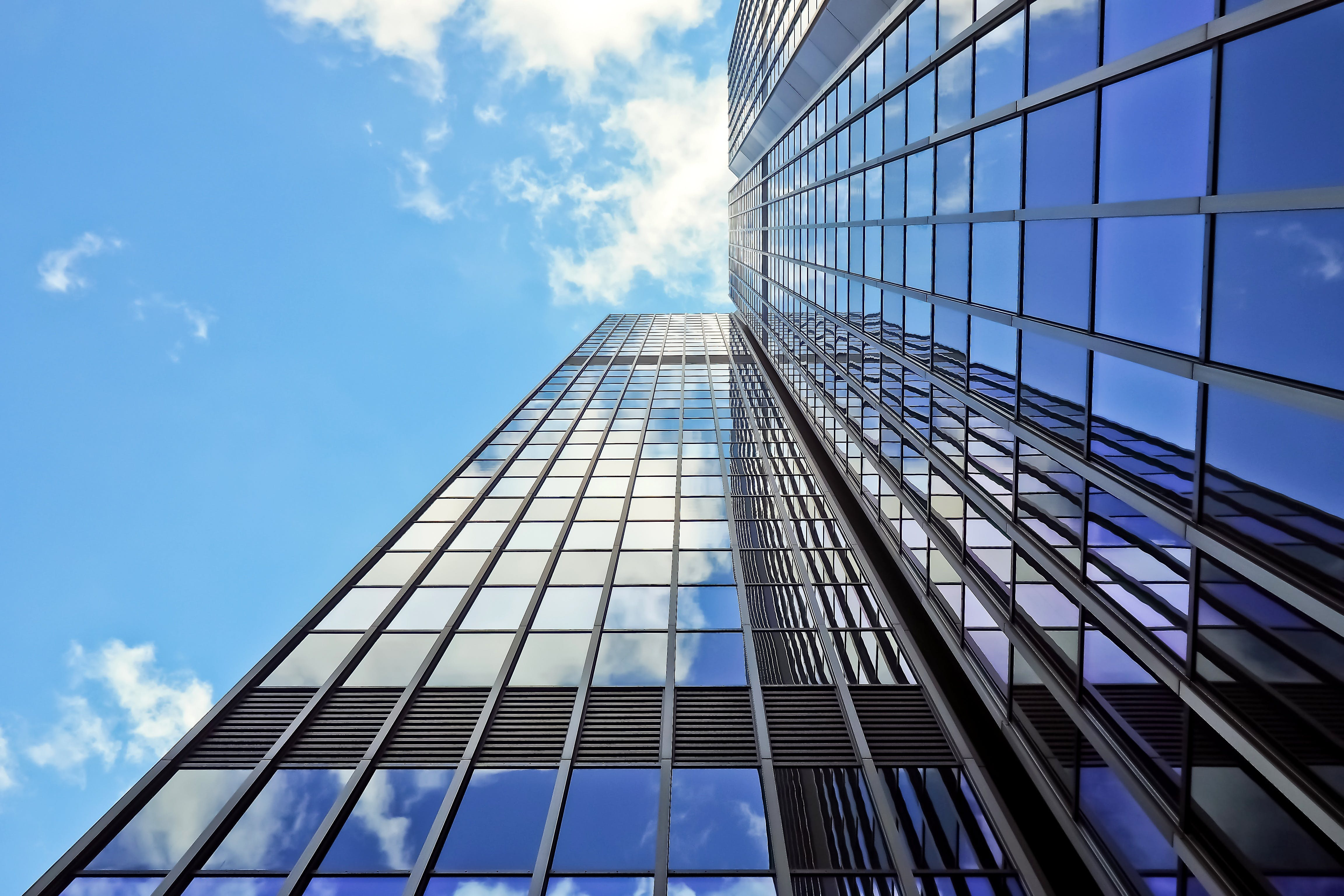 Gray Glass Window High-rise Building With Sky Reflection