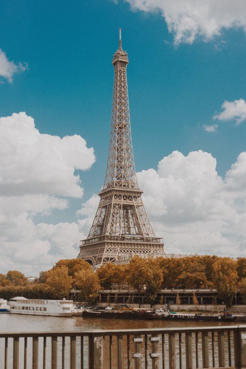Eiffel Tower Under Blue Sky and White Clouds