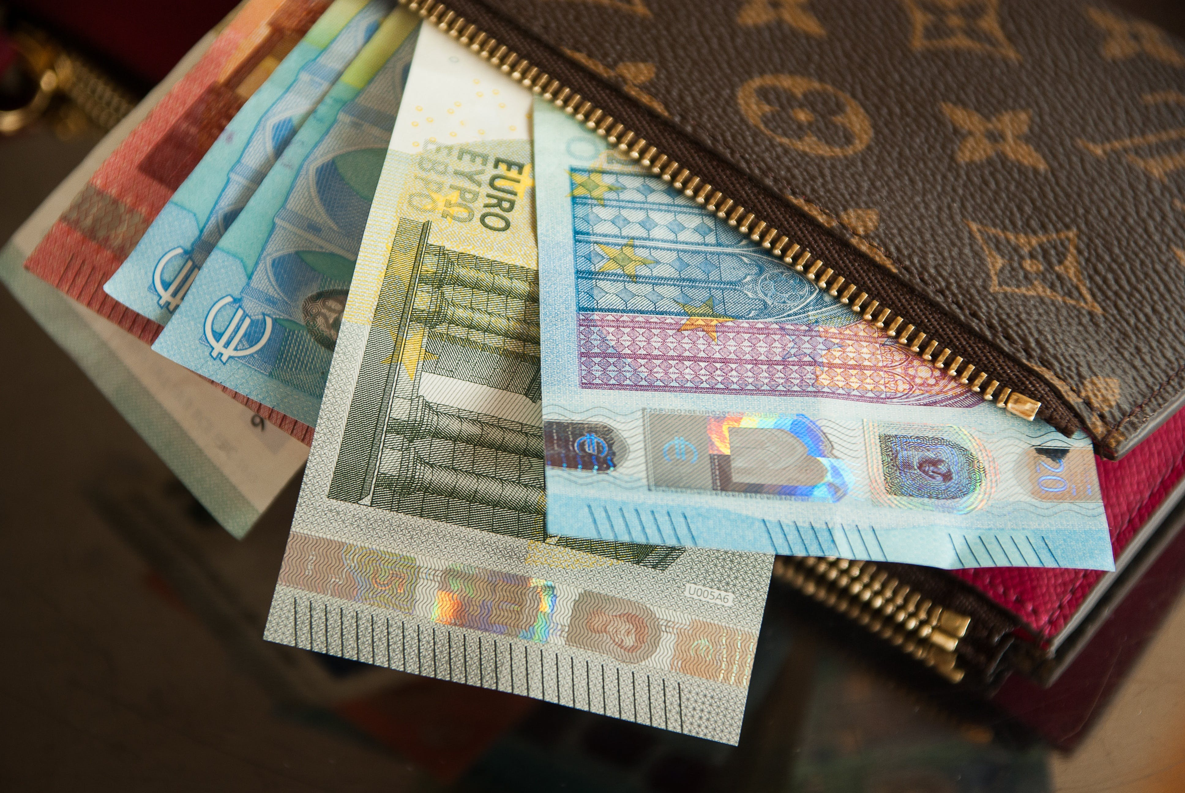 Several Euro Banknotes in Louis Vuitton Wallet