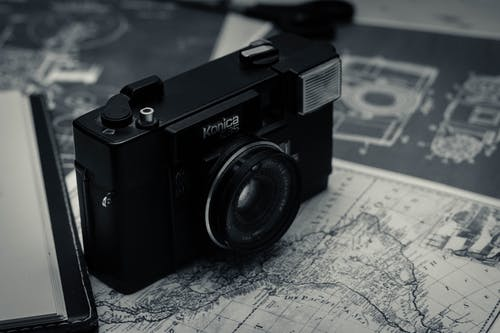 Traveling retro photo camera and map