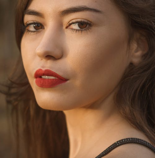 Young woman with red lips and makeup