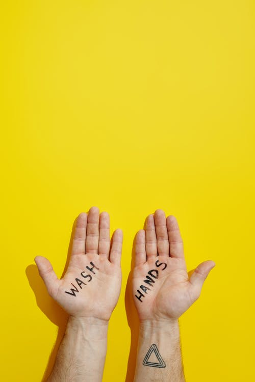 Hands With the Words Wash and Hands Written on Them