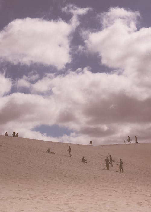 Travelers walking along desert land