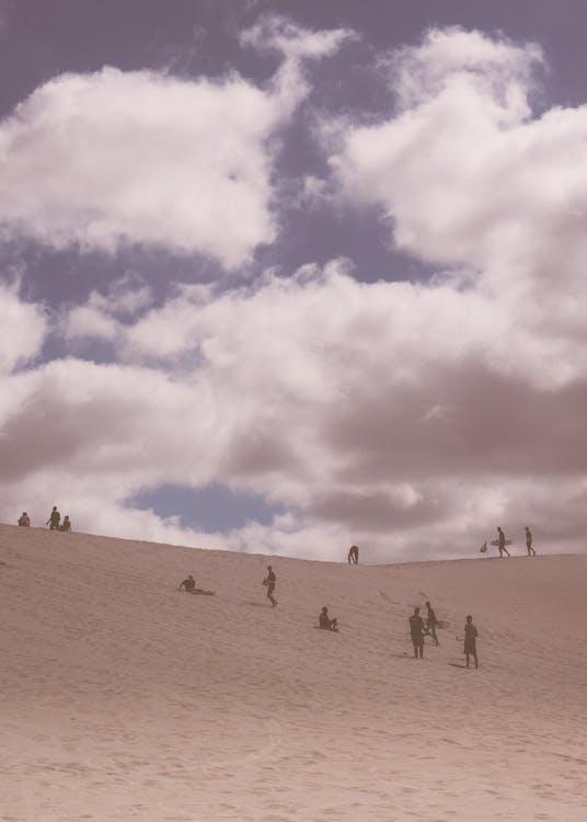 Travelers walking along desert land
