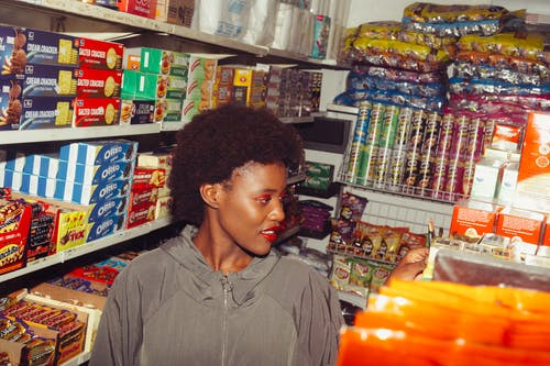 Ethnic woman choosing products in grocery store