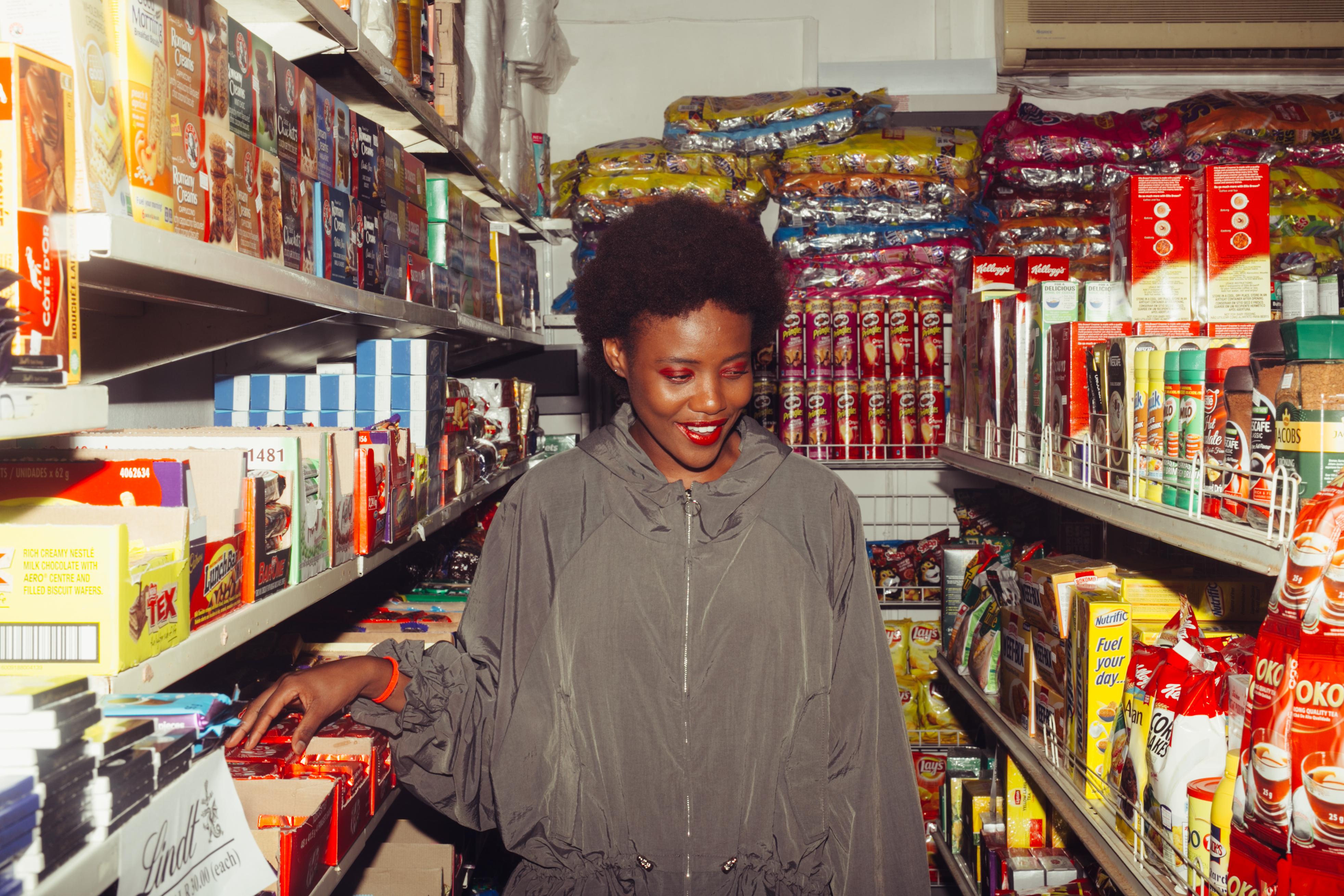 ethnic woman choosing food in supermarket