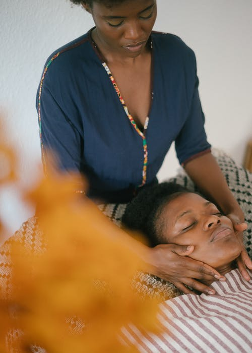 Ethnic woman doing massage to client