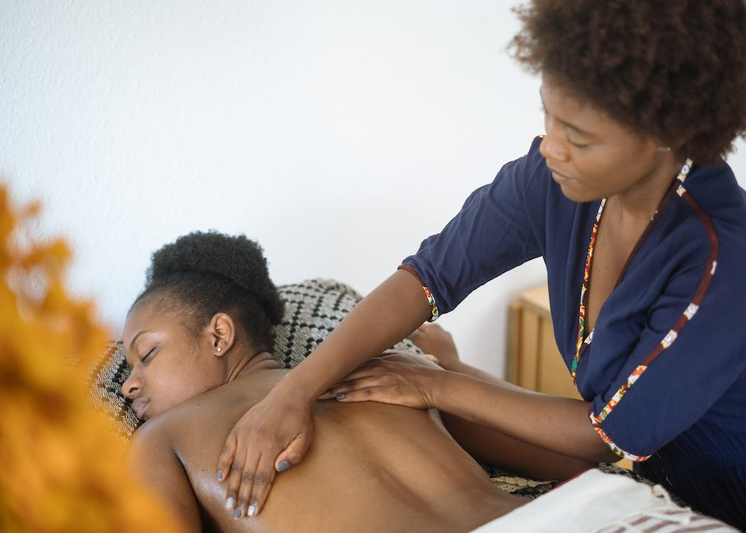 Focused woman doing massage to relaxed client