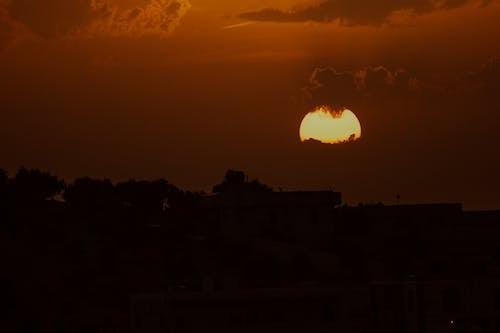 Bright moon over city at dusk