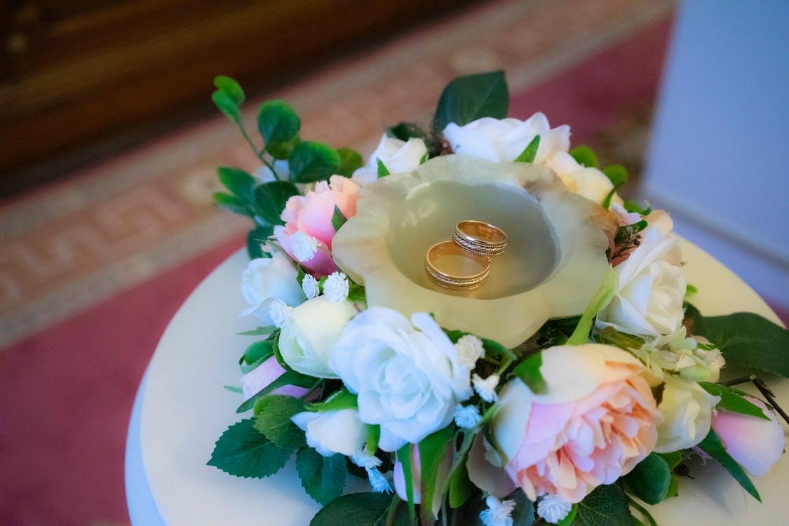 Wedding rings on white table