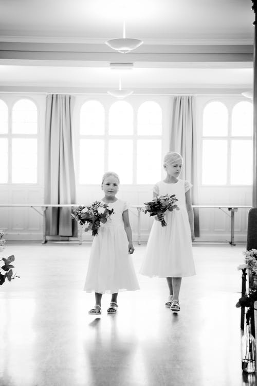 Kids walking with bouquet of flowers