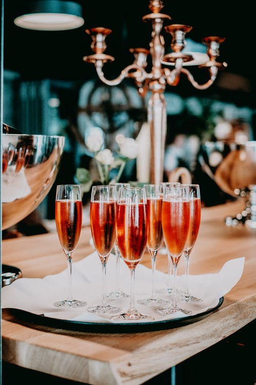 Glasses of champagne on wooden table