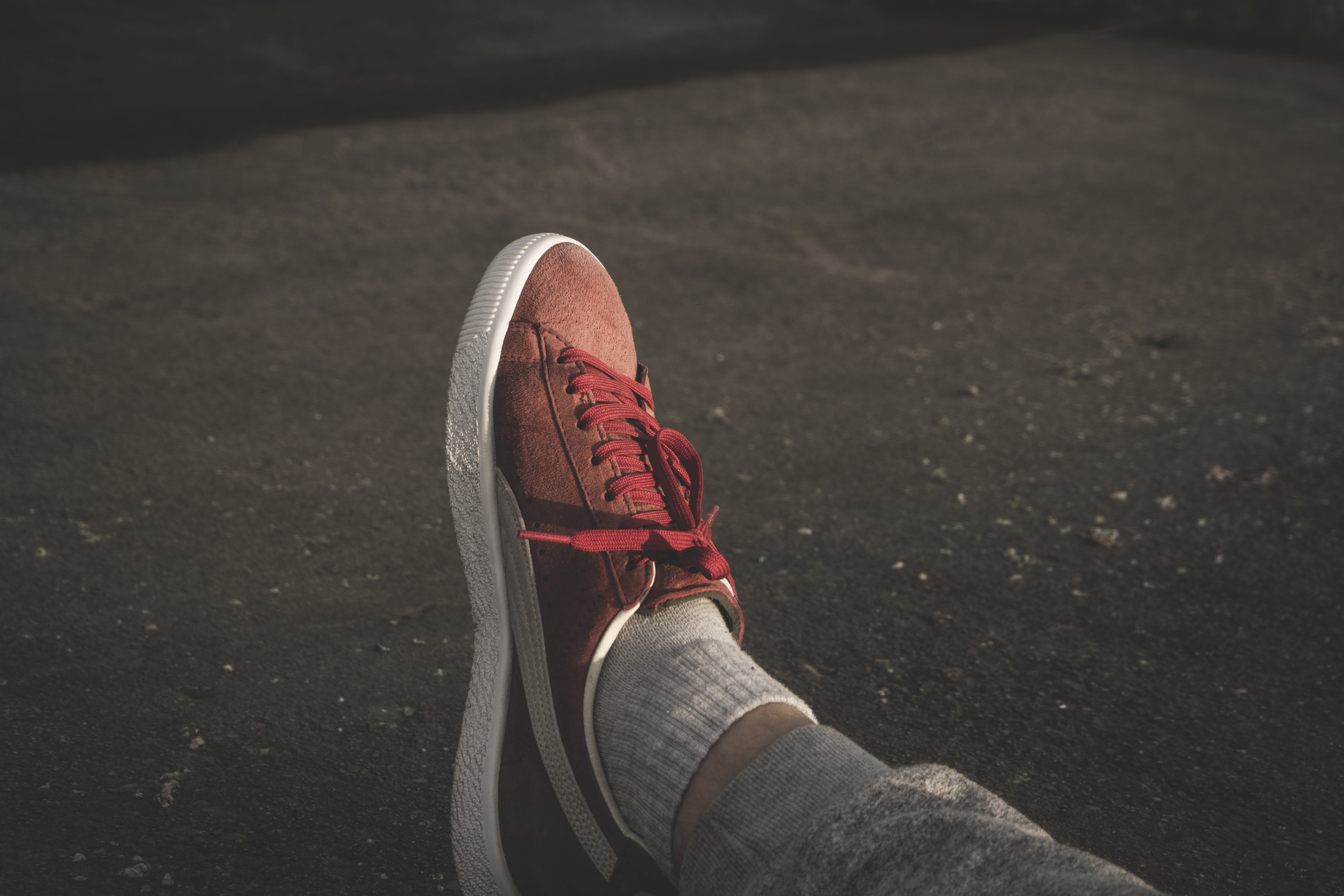 Person Wearing Red Puma Sneaker