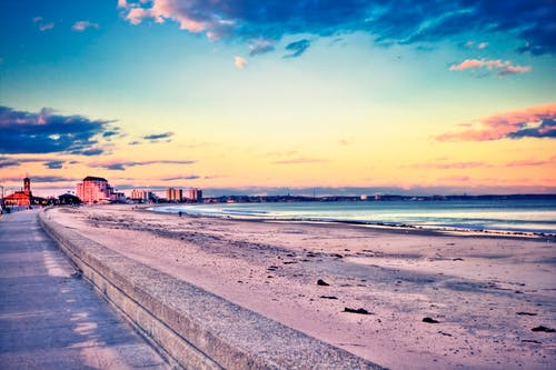 Бесплатное стоковое фото с вода, волны, здания, море