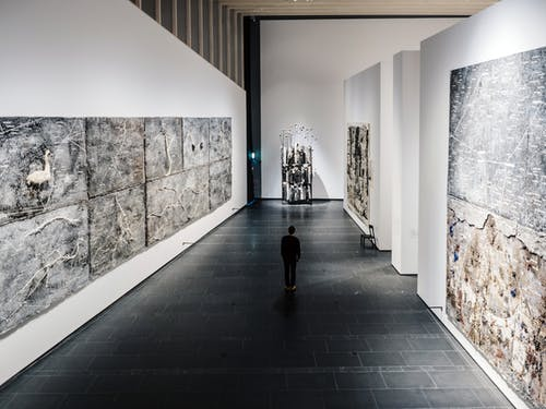 Person Standing in a Museum