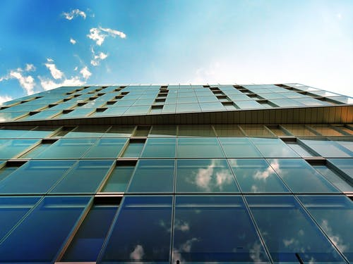 Low-angle Photography of Mirror Glass Curtain Building