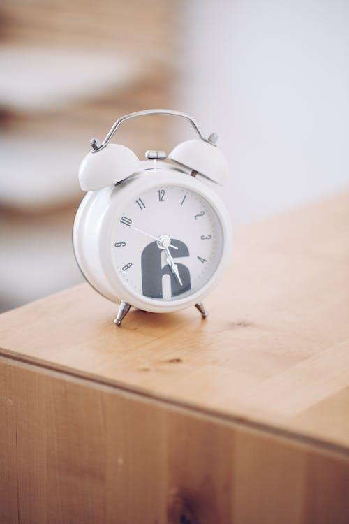 White Alarm Clock at 10 00