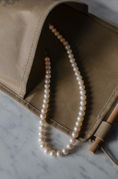 Pearl beads in zero waste bag on table