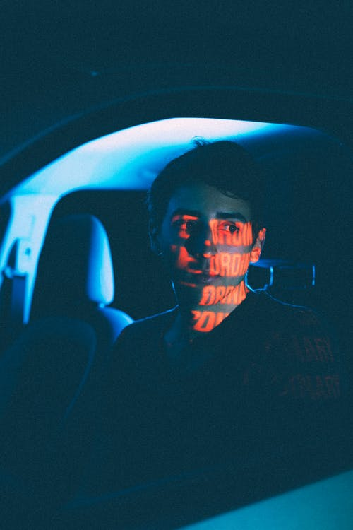 Dreamy man in car with shadow on face