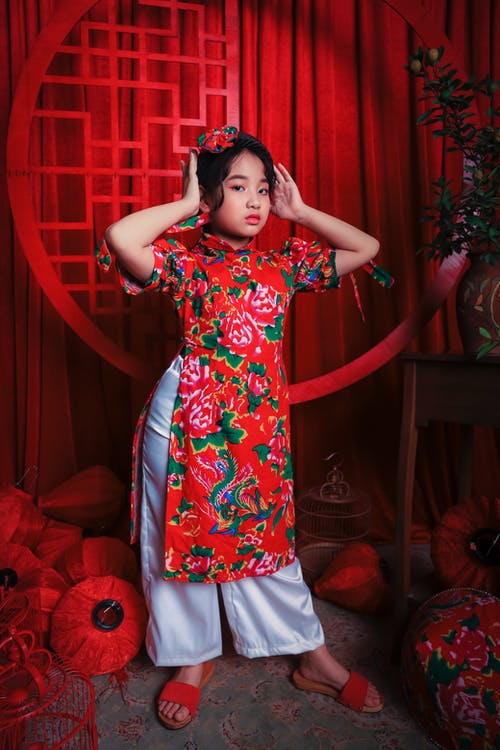 Stylish Asian kid in colorful traditional clothes