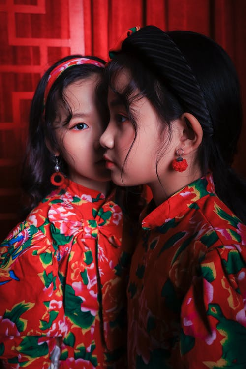 Trendy Asian girls in colorful clothes and earrings