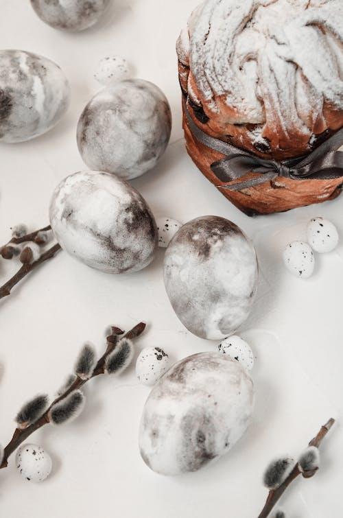 White Round Fruits on White Surface