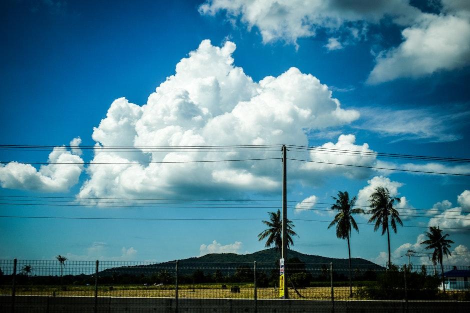 backlit, building, clouds