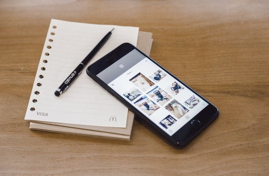Free stock photo of smartphone, notebook, pen, technology