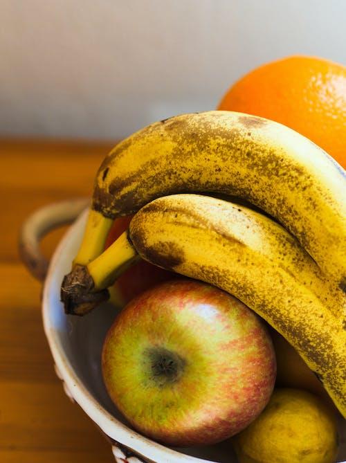 Foto profissional grátis de banan, čerstvé ovoce, červené jablko, citrusové ovoce