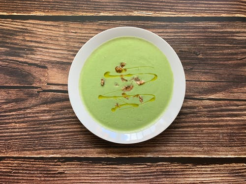 Delicious broccoli cream soup served in bowl