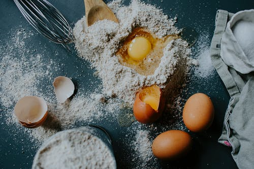 Flour and eggs scattered on table before bread baking