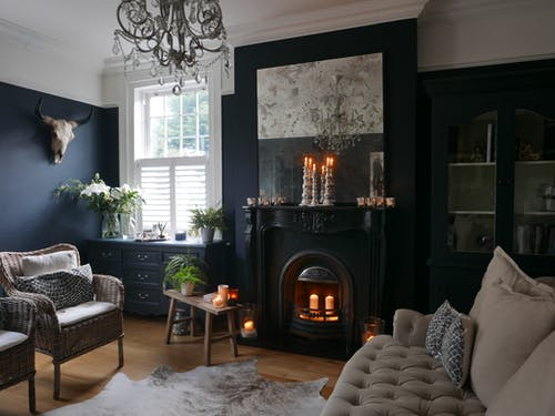 Interior of elegant living room with fireplace and vintage furniture