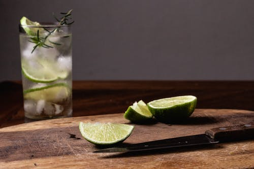 Sliced Lime on Clear Drinking Glass