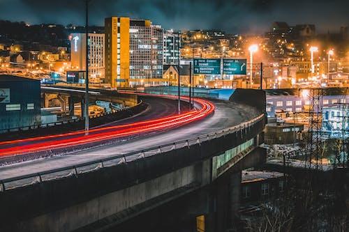 Traffic on paved night road on bridge in city