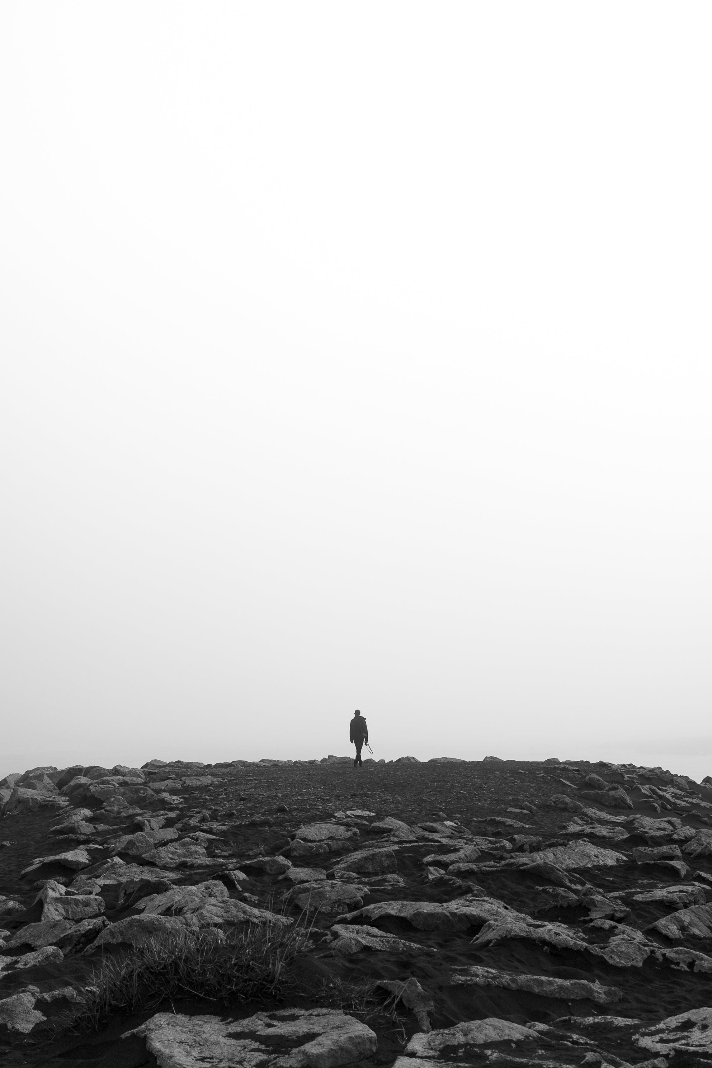 Free stock photo of person, beach, rocks, silhouette