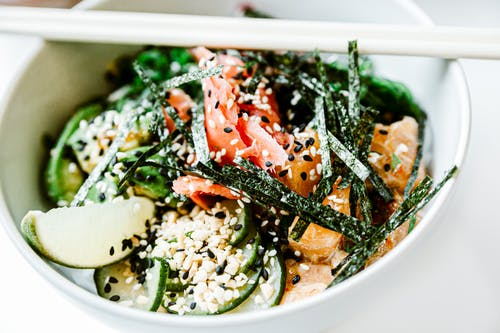 Asian salad with seaweeds and fish with sesame seeds