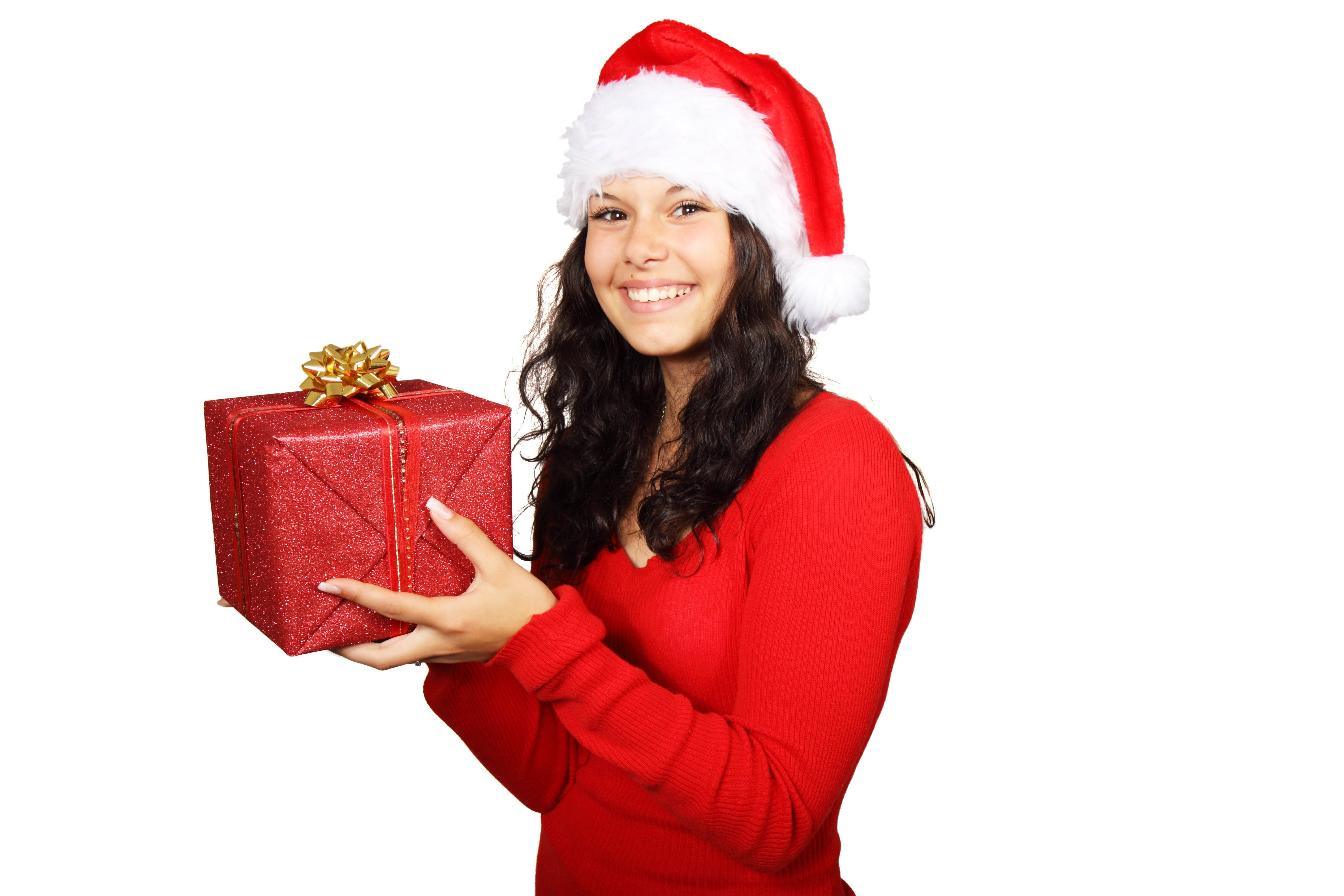 Smiling Woman in Red Long Sleeve Shirt Holding Red Gift Box