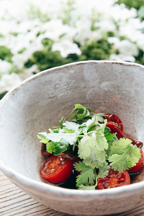 Bowl of healthy salad with tomatoes and parsley