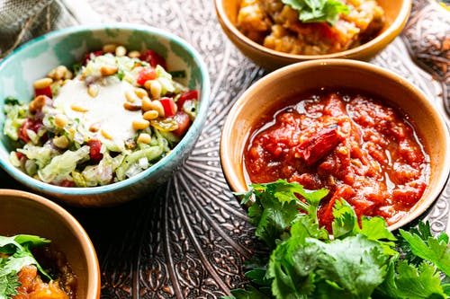 Bowls with tasty vegetable salad and meat stew