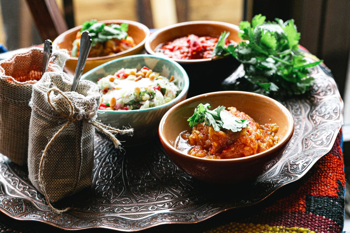 Bowls with meat stew salads and spices