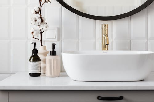 White Ceramic Sink With Gold Faucet