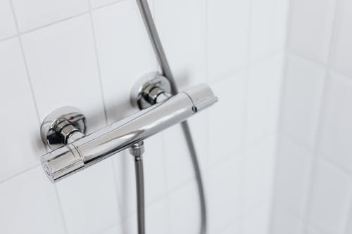Stainless Steel Pipe on Ceramic Wall