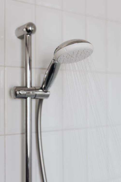 Stainless Steel Shower Head on White Ceramic Bathtub