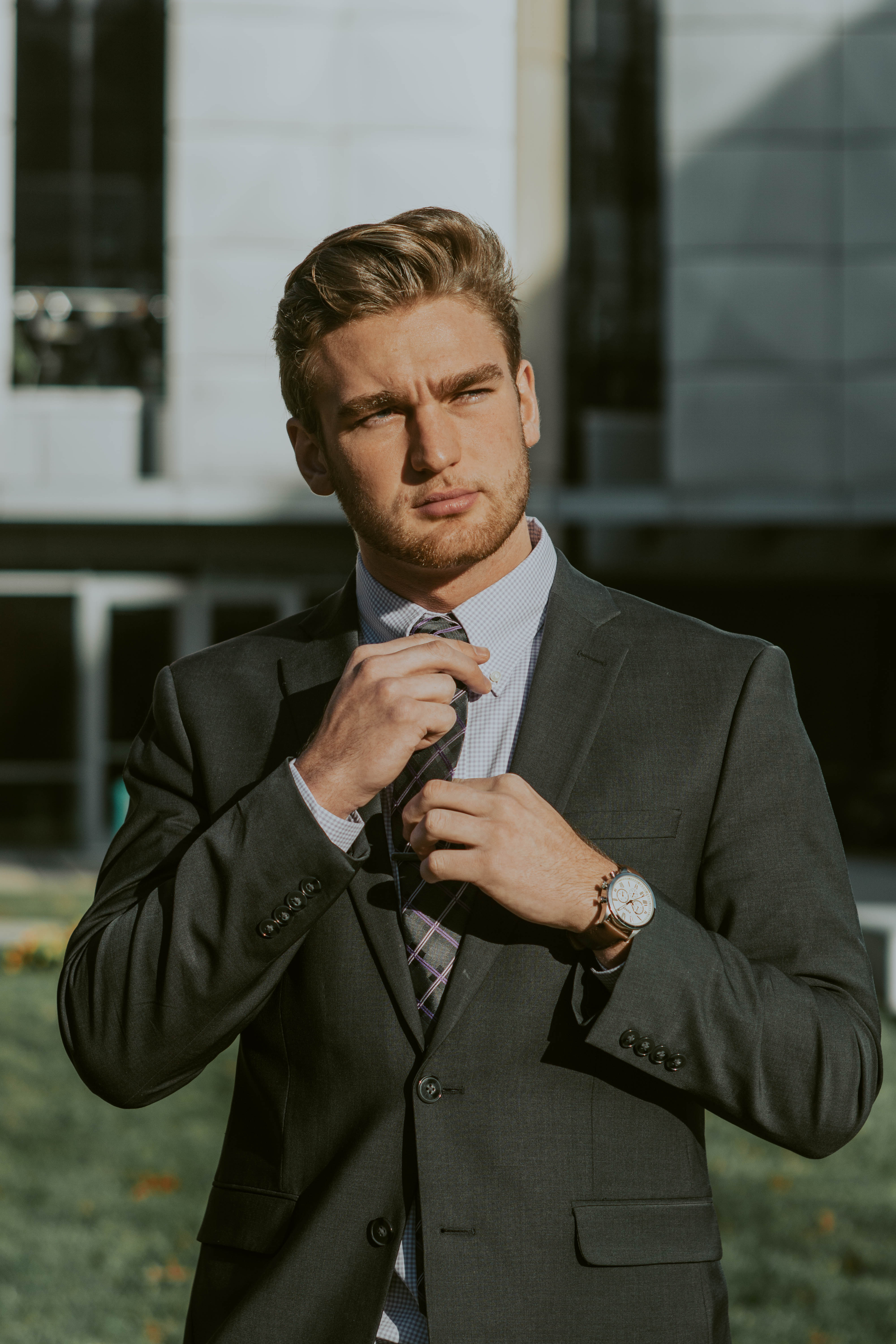 elegant young bearded businessman in suit and tie in downtown