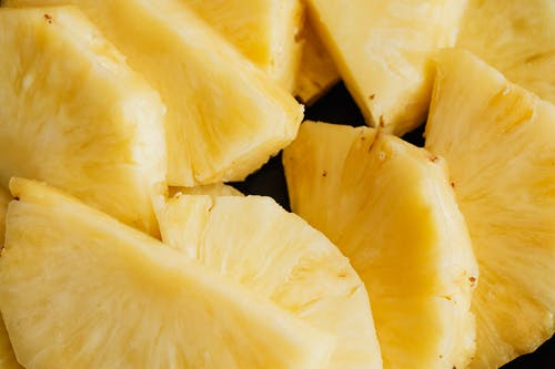 Halves of fresh ripe sliced pineapple