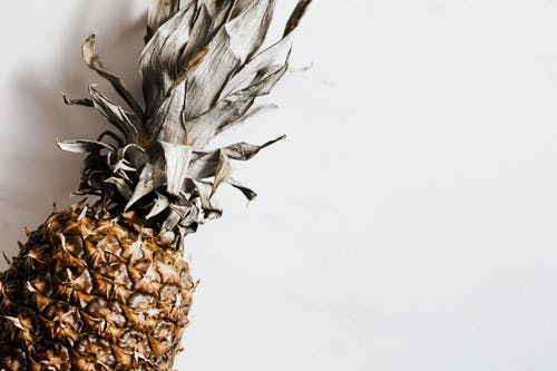 Healthy tropical pineapple on white background
