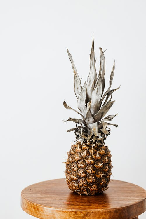 Whole pineapple on small round table