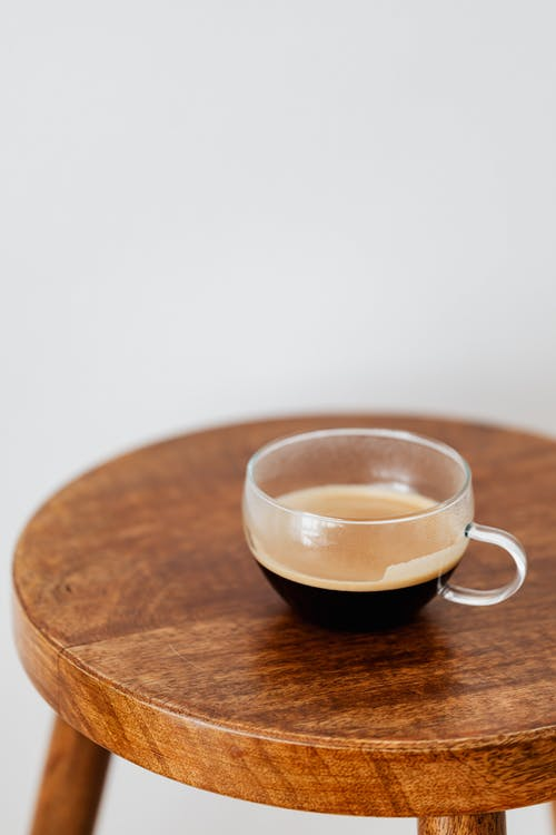 Black coffee in wide cup standing on small table